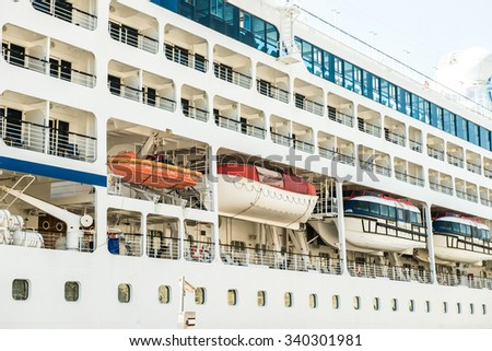 touristic liner with rescue boats close-up - stock photo