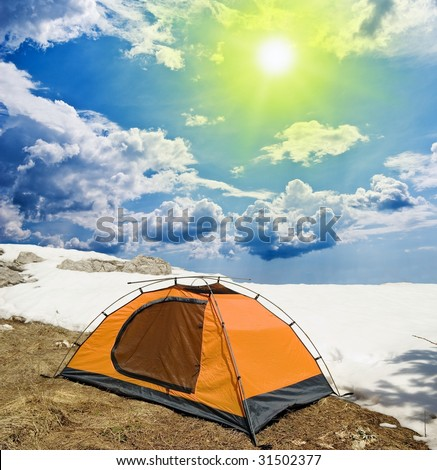 touristic stand into the snow - stock photo