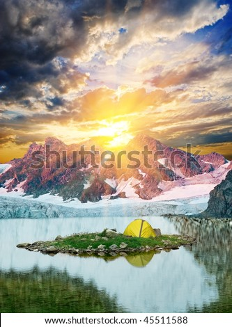 touristic stand on a mountain lake at the evening - stock photo