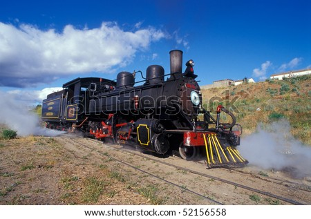 Touristic steam engine train leaving the station in Patagonia, Argentina. - stock photo