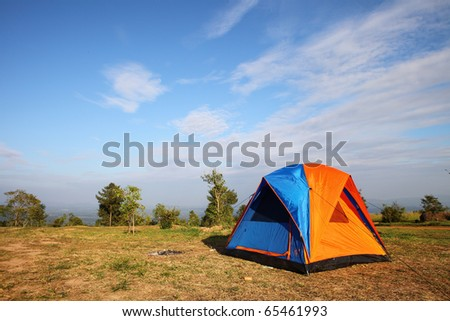 touristic tent in a forest glade - stock photo