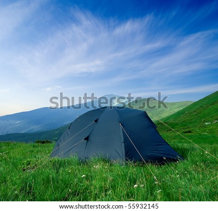 touristic tent in a green hills - stock photo