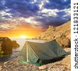 touristic tent on a sea coast at the morning - stock photo