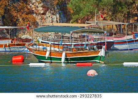 Touristic vessels moored at the sea shore in Marmaris, Turkey - stock photo