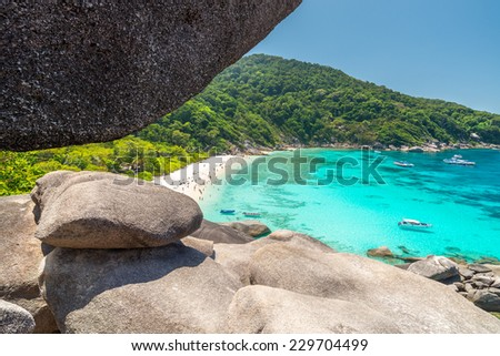 Tourists and boats in a bay Sailing Boat Rock on Koh Similan (Island No.8) - stock photo