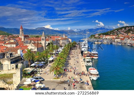 Tourists and boats in the harbor of old Venetian town, Trogir, Croatia - stock photo