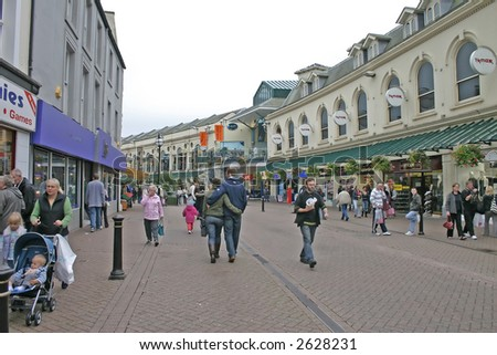 Tourists and Shoppers in Torquay, Devon, England, UK - stock photo