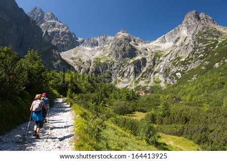 Tourists approaching to the chalet at Zelene pleso, High Tatras, Slovakia - stock photo