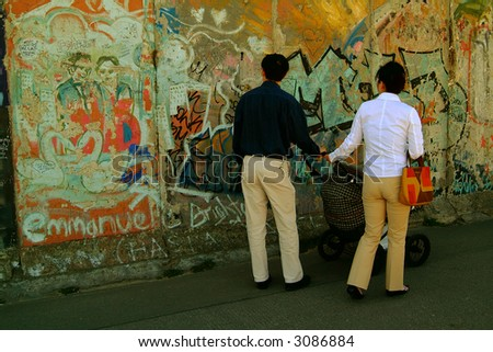 tourists at berlin wall - stock photo