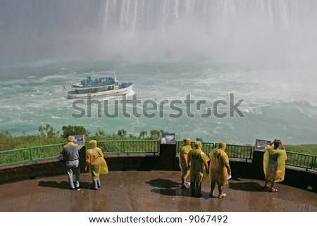 tourists at niagara falls ontario - stock photo