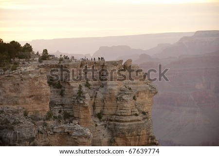 Tourists at scenic viewpoint overlooking the Grand Canyon, South Rim, Arizona, USA. - stock photo