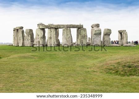 Tourists at Stonehenge - stock photo