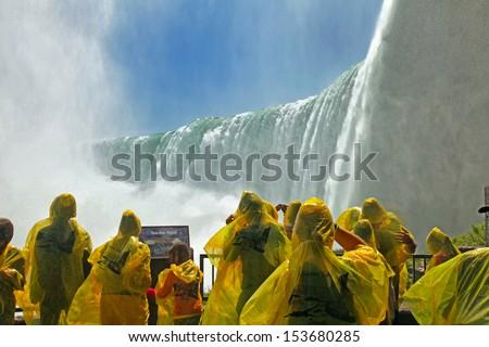 Tourists at the Horseshoe Fall, Niagara Falls, Ontario, Canada - stock photo
