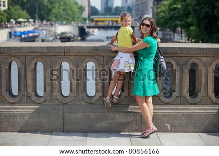 Tourists. Beautiful mother and daughter walking in berlin city. - stock photo