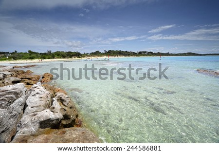 Tourists can enjoy an idyllic paradise with crystal clear waters at Currarong Beach, Jervis Bay NSW Australia - stock photo