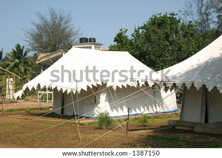 Tourists can live in tents like these during their 3 day long massage therapy run by & Large White Tent Events Stock Photo 1464770 - Shutterstock