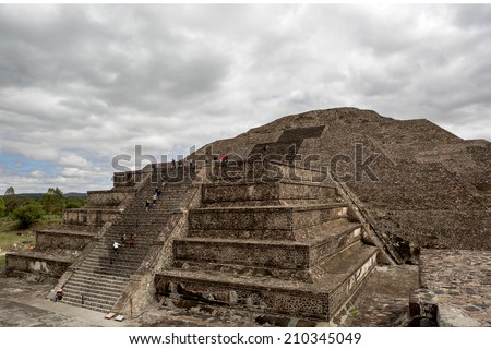 tourists climbing on the stairs of the pyramid of the Moon in the ancient city of Teotihuacan  - stock photo