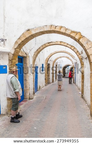 tourists family visit an old alley in Safi, Morocco - stock photo