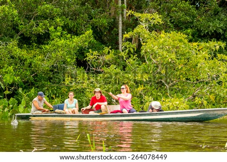 TOURISTS FISHING LEGENDARY PIRANHA FISH IN ECUADORIAN AMAZONIAN PRIMARY JUNGLE  - stock photo