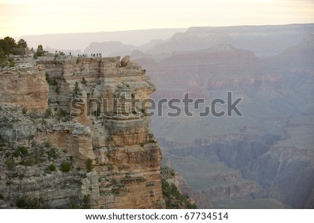 Tourists gather to the Grand Canyon overview, south rim. - stock photo