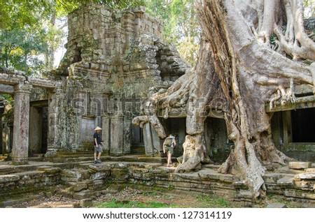 Tourists in Preah Kahn temple, Angkor, Cambodia