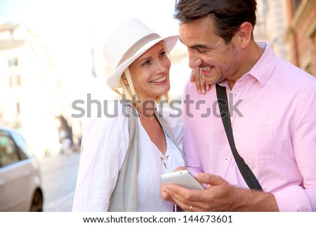 Tourists in Rome using smartphone in the street - stock photo