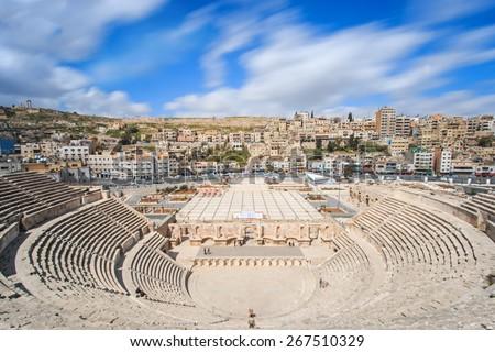 Tourists in the Roman amphitheatre of Amman, Jordan - stock photo