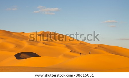 Tourists in the sand dunes of the Sahara Desert, Libya - stock photo