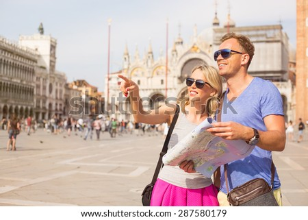 Tourists in Venice looking for directions