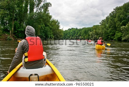 Tourists kayaking on river Dordogne in southern France - stock photo