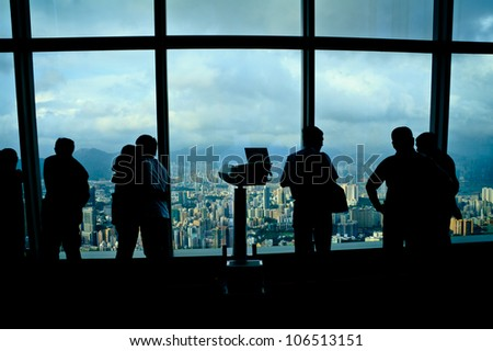 Tourists Looking At High Angle Hong Kong City View From One Hundred Floors Building - stock photo