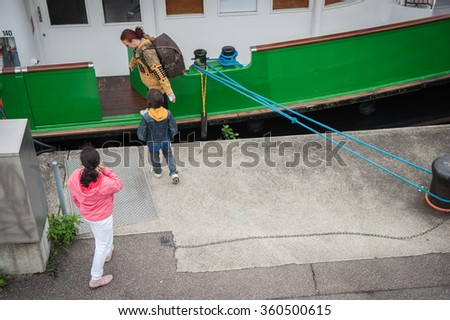 Tourists on a boat - stock photo