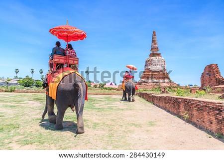 Tourists on an elephant ride tour of the ancient city Ayutthaya Asia Thailand - stock photo