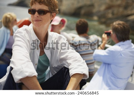 Tourists on Excursion Boat - stock photo