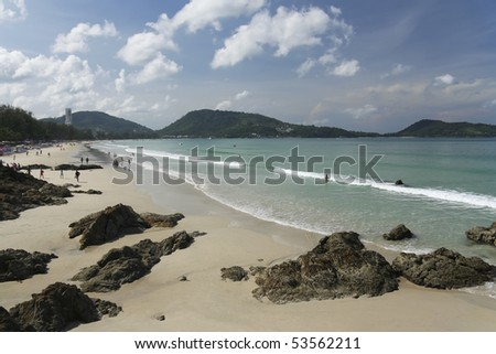 tourists on patong beach, phuket island, thailand