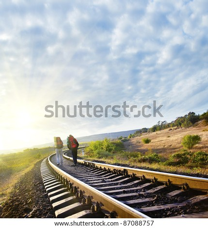 tourists on railroad - stock photo