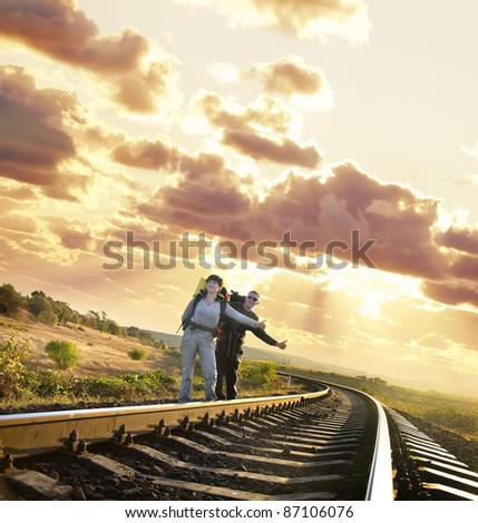 tourists on railway - stock photo