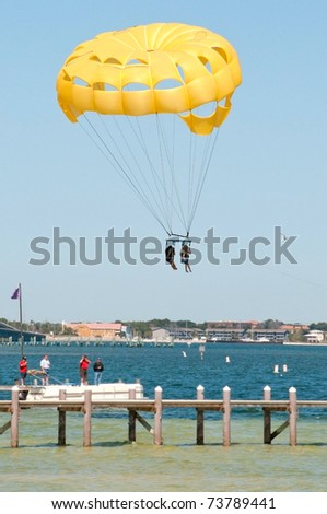 Tourists parasailing in Pensacola, Florida