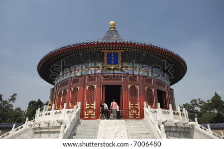 Tourists peeking into a pavilion on the Temple of Heaven grounds, Beijing. - stock photo