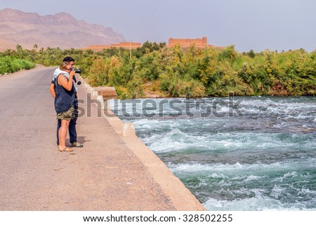 Tourists photographing Draa River, Morocco
