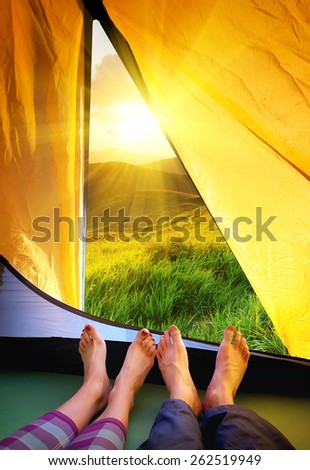 Tourists relax in camp. Active life concept - stock photo