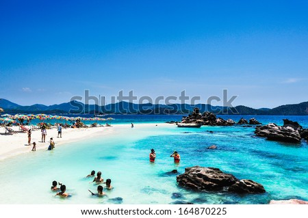 Tourists Relax on the beach in Phuket, Thailand - stock photo