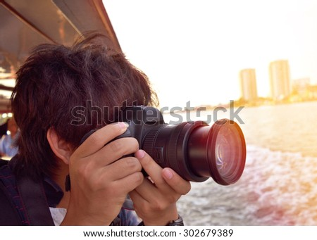 Tourists shoot landscapes along the river bank. - stock photo