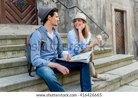 Tourists sightseeing city with map - stock photo