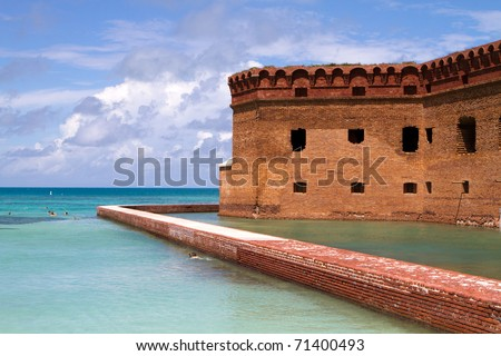 Tourists snorkel the clear calm waters surrounding Fort Jefferson National Park in the Dry Tortugas, which is part of the Florida Keys. - stock photo
