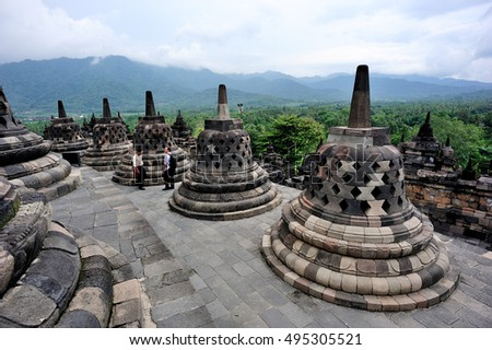Tourists stand on Borobudur Temple, Magelang, Central Java, Indonesia. This photo was taked on 23 January 2015
