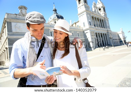 Tourists standing by the Almudena Cathedral of Madrid - stock photo