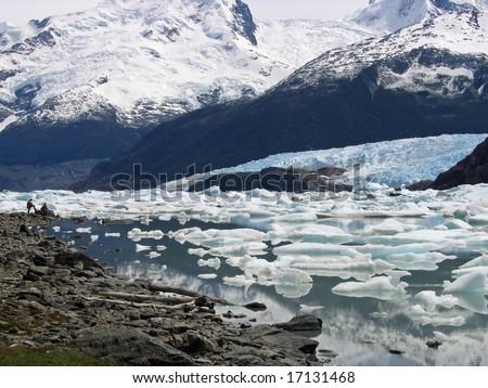Tourists Surveying a Glacier in Parque Nacional Los Glaciares Argentina - stock photo