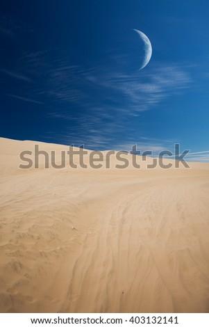 Tourists travel through the dunes in the Atacama Desert. Oasis of Huacachina, Peru, South America. moon shines - stock photo