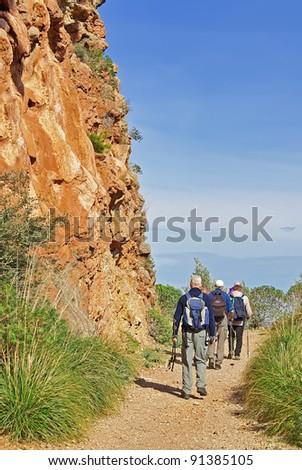 Tourists trekking in Majorca (Spain) - stock photo